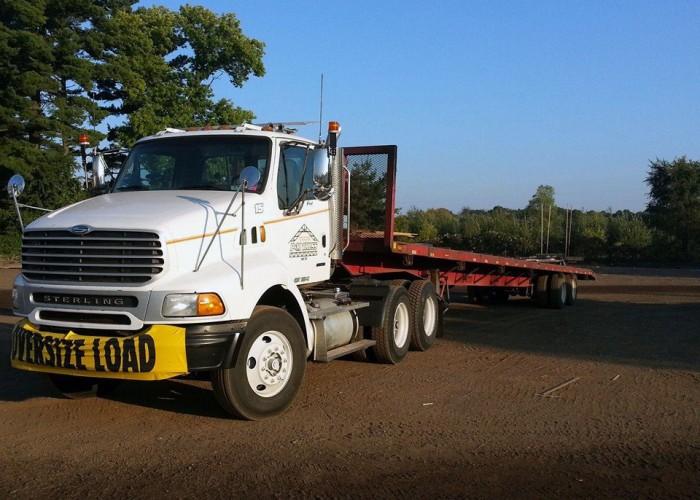 P&M Truss, Inc. Trucks on the job